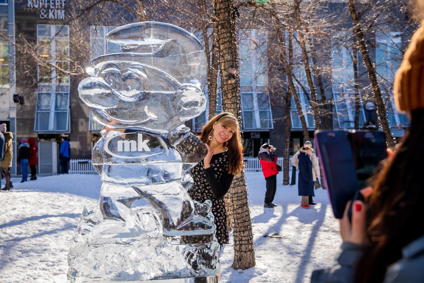 Person poses with a Smirf sculpture at Icefest 2020