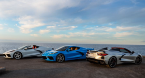 Sports cars by the ocean