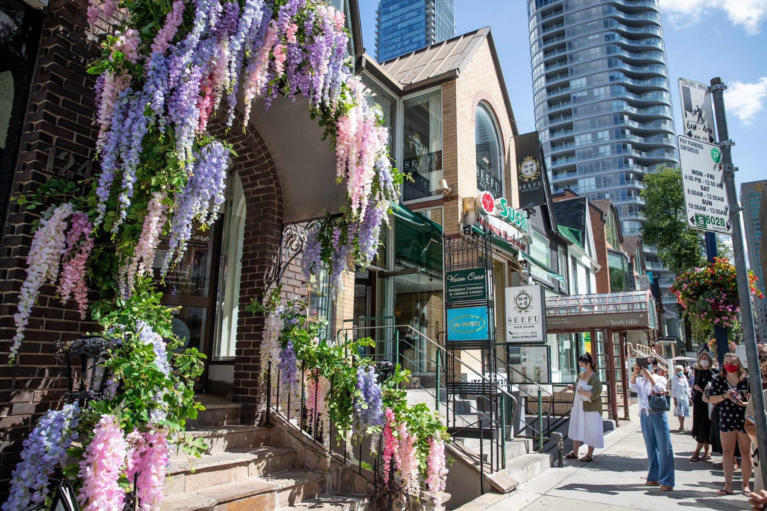 multi coloured flowers on outside of a bloor yorkville business